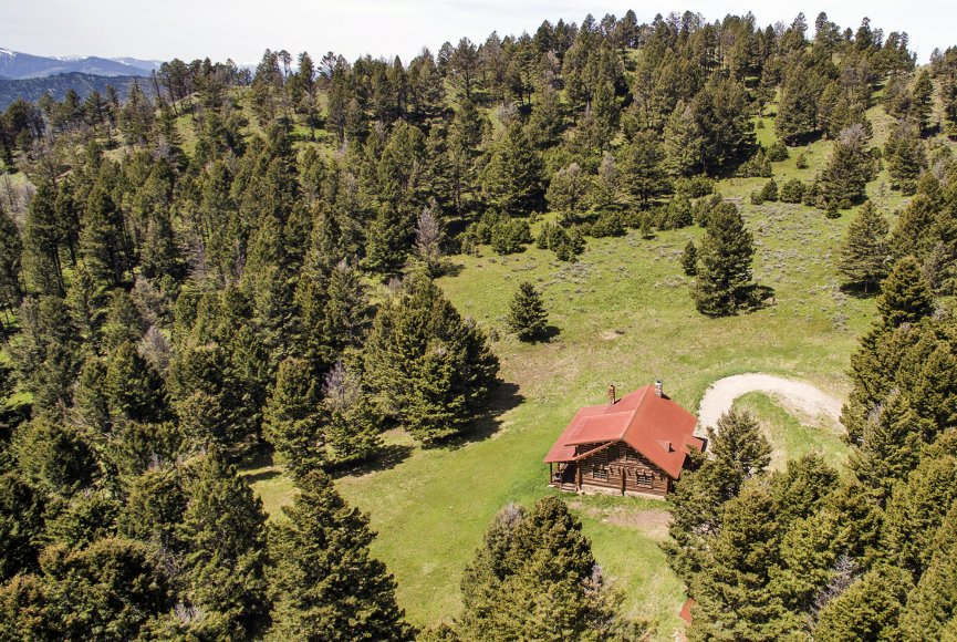 Alpine cabin on this Montana property for sale