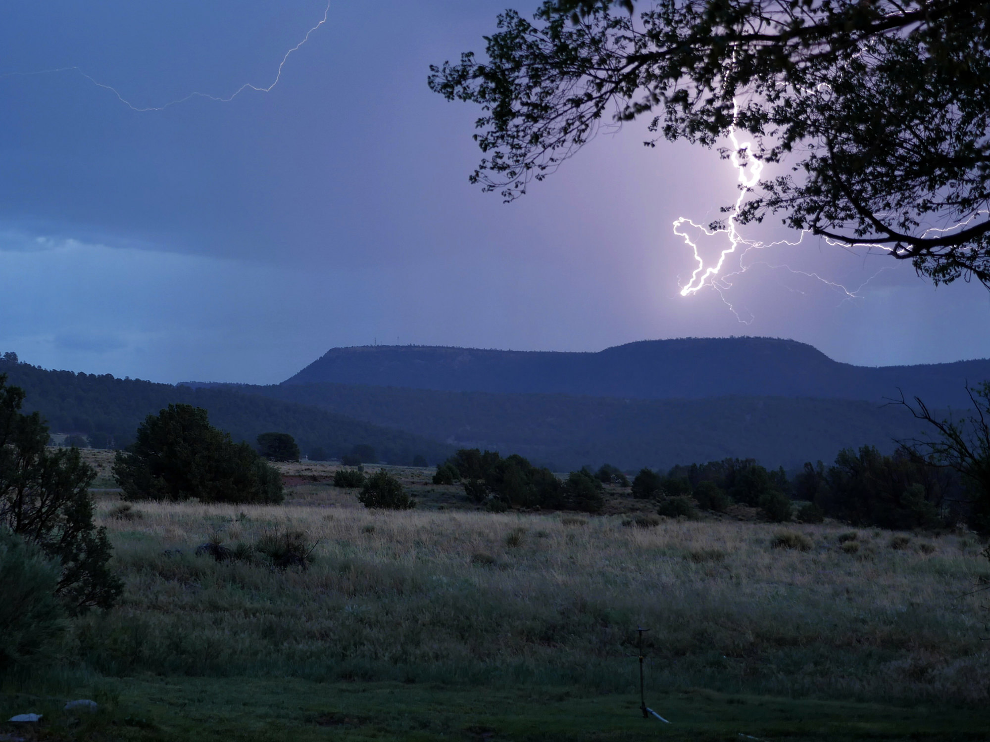 Forked Lightning Ranch for sale with a lightning bolt in the sky & Forked Lightning Ranch - SOLD | Swan Land Company