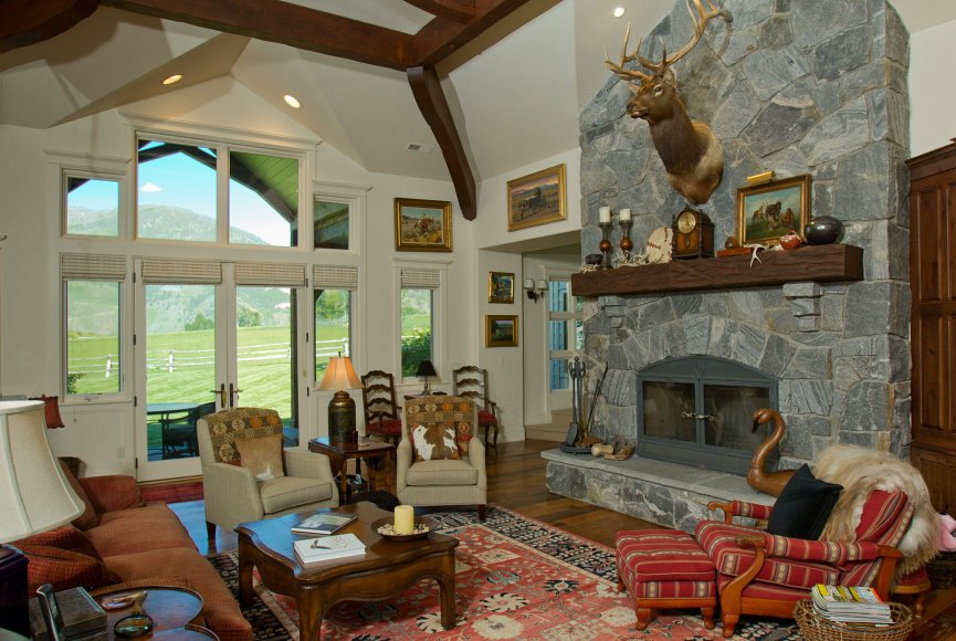 A grand fireplace on this Montana ranch for sale
