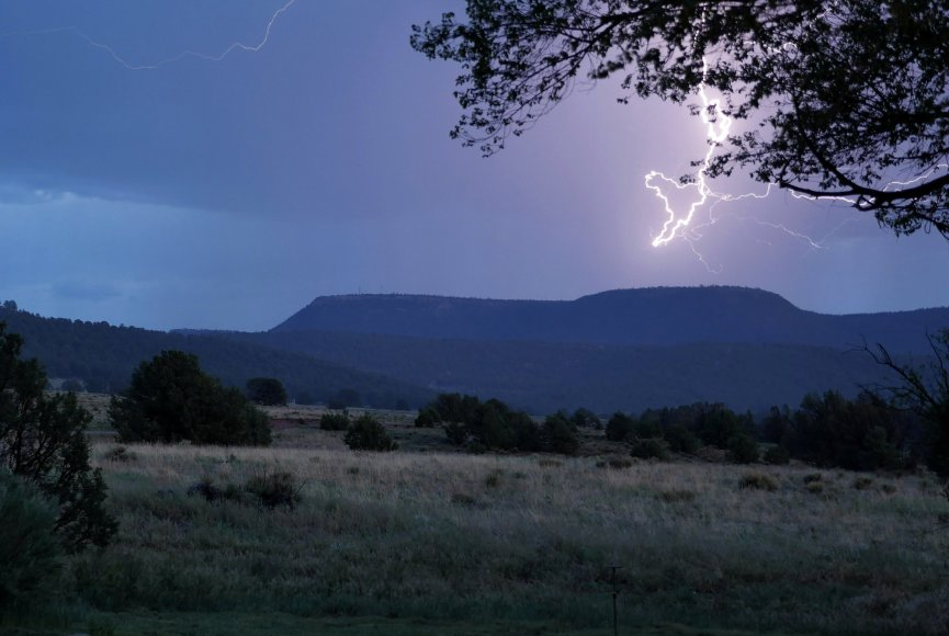 Forked Lightning Ranch for sale with a lightning bolt in the sky