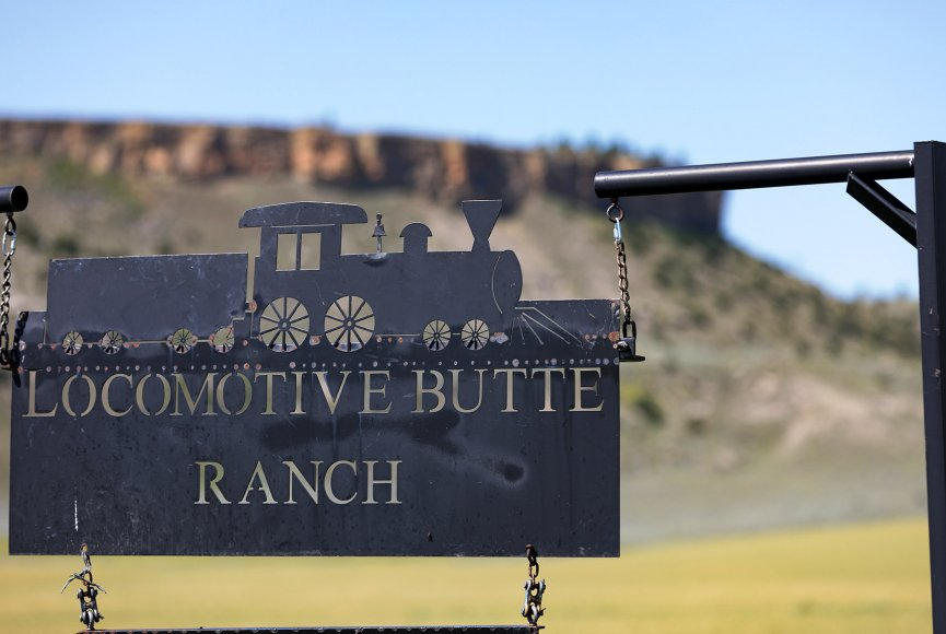 A clever sign invites you onto this Montana ranch for sale