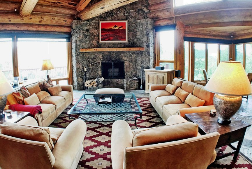 Fireplace on this Montana ranch for sale is a welcoming sight